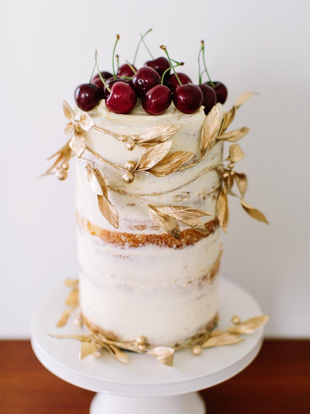 Vanilla bean butter-cream cake with fresh cherries