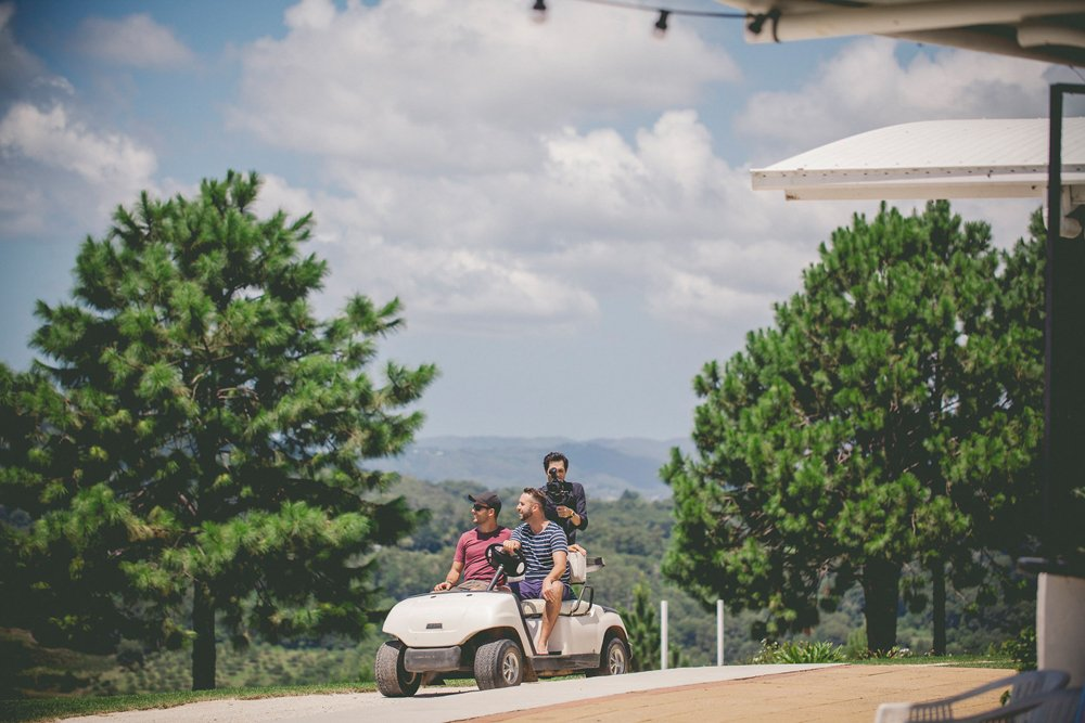 cody and friends riding in a golf cart